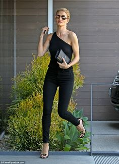 Legs for days: The VS angel was seen in Beverly Hills on Thursday wearing all black...