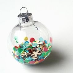 Create an easy and festive ornament in under five minutes with sequins and wood veneer pieces!