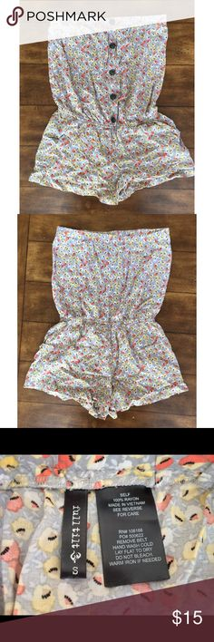 Strapless Floral Romper So cute! Staples floral romper with buttons and POCKETS! Gray with reddish-orange and yellow flowers. Super comfortable! Bought from Tilly's and only worn a couple times. Full Tilt Other