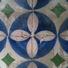 Portuguese tile. Love the timeless pattern and vivid colors! Handmade tiles can be colour coordinated and customized re. shape, texture, pattern, etc. by ceramic design studios