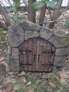 Castle door painted in stone