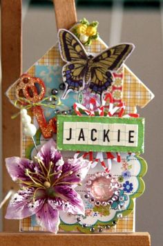 Altered a maya road house-shaped chipboard into this tag for home decor.