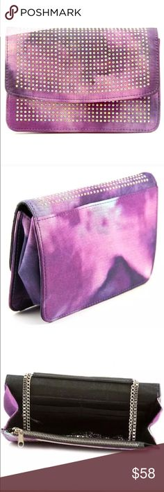 """Steve Madden Bi Dreamy Purple Messenger NWT Steve Madden Bi Dreamy Purple Messenger NWT New with tags / retail BRAND/STYLE: Steve Madden Bi Dreamy COLOR: Multi /purple MATERIAL: Canvas , DIMENSIONS: 7.5"""" W x 5.5"""" H x 2"""" D , SHOULDER STRAP DROP: 23.5 in. SKU: 1836854 MSRP Made of quality Canvas materials, beautiful rhinestone detail, clutch shoulder combo! All purchases are final on Poshmark so please ask questions if needed. Love with all orders! ships FAST! Steve Madden Bags Crossbody Bags"""