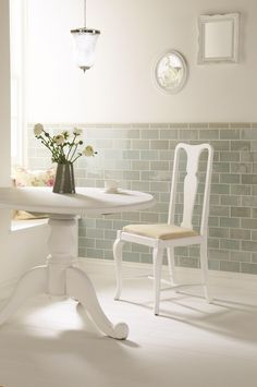 These glossy half tiles in Sudbury show that tiles don't have to be relegated to kitchens and bathrooms, they cal adorn walls all over the home. The matching mouldings add a sophisticated finish. Handmade ceramic tiles, made in the UK. winchestertiles.com