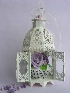Cupcake in a bird cage by bubolinkata, via Flickr