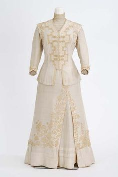 Circa 1908 eggshell color silk dress and jacket trimmed with lace and braid. Made by dressmaker Sister Mary Abigail Molloy, St. Paul, Minnesota.