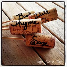 One Acre Fort- wine cork herb markers...hmm this is an excellent use of way too many corks I have