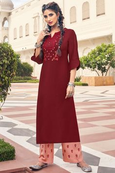 Bright and colourful, this dark maroon rayon trouser suit which will keep you comfortable and easy on the eye at the next social function. This round neck and 3/4th sleeve party wear outfit designed with zari work. Set together with rayon palazzo pant in light peach color with peach chiffon dupatta. Palazzo pant has resham work. Dupatta highlighted with plain work. #trousersuit #salwarkameez #malaysia #Indianwear #Indiandresses #andaazfashion Trouser Suits, Trousers, Women Salwar Suit, Light Peach Color, Moroccan Caftan, Modest Wear, Maroon Dress, Dress Suits, Indian Dresses