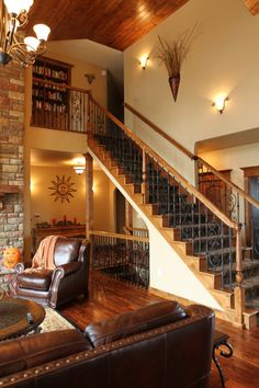 Stair Systems   wrought iron staircase with Oak handrails   Bayer Built Woodworks