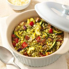 Slip slices of summer squash, zucchini, and eggplant into this rice-based casserole recipe that's studded with roma tomatoes and corn kernels. The dish owes its rich flavor to the white wine broth and basil pesto./