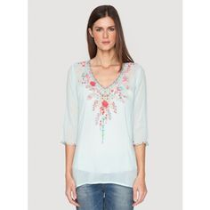 Swan Blouse The Johnny Was SWAN BLOUSE features a feminine floral embroidery design on flowy rayon georgette. Pair this embroidered blouse with a silk camisole, boyfriend jeans, and sandals for an easy-going bohemian look!  - Rayon Georgette - V-Neckline, ¾ Length Sleeves - Signature Embroidery - Care Instructions: Machine Wash Cold, Tumble Dry Low - Model's Height is 5'10