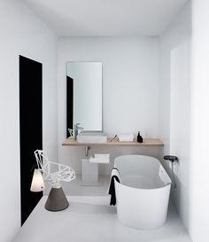Sleek modern minimalist bathroom full of clean, geometric shapes. Perfect if you love the no-fuss look.