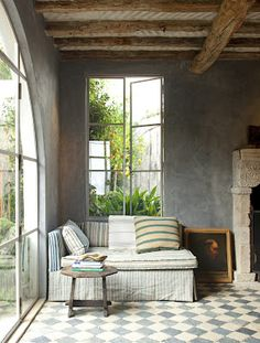 photo by Tim Street-Porter...love the cozy nook/daybed and floors and windows