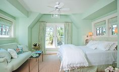 mint walls, white linens. Notice how much this room needs a warm color like cream or wheat.