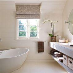 vory  gray modern sophisticated bathroom design with modern freestanding soaking tub, gray paisley silk roman shade, gray bathroom vanity and round pivot mirror. PERFECT