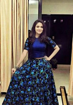 Malavikha Wales in blue crop top with floral print skirt
