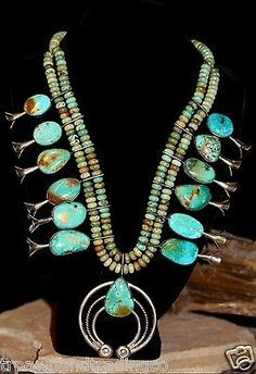 Squash blossom necklace with stunning green turquoise.