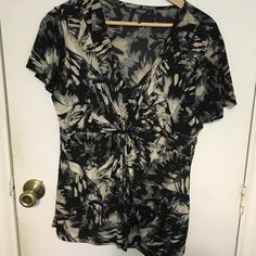 NWOT Daisy Fuentes top New Daisy Fuentes top. Black and gray. Gathered in front at chest. V neck. Very flattering.  Bundle 2 or more items from my closet and save 15%!! Daisy Fuentes Tops Blouses