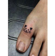Cat tattoo on toe