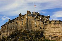 Edinburgh Castle was built high on bedrock, so it didn't need a moat. The next few pages explore landmarks in France, starting with the most famous palace in the world.
