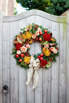 Christmas wreath on rustic country gate door.