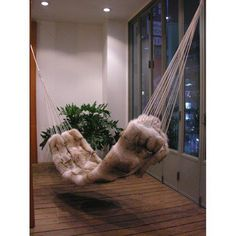 This fur hammock looks very cozy and warm.
