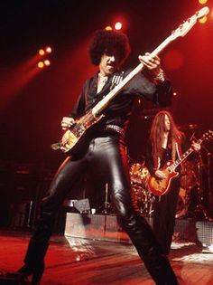 phil-lynott-singer-of-thin-lizzy-singing-on-stage-playing-guitar.jpg