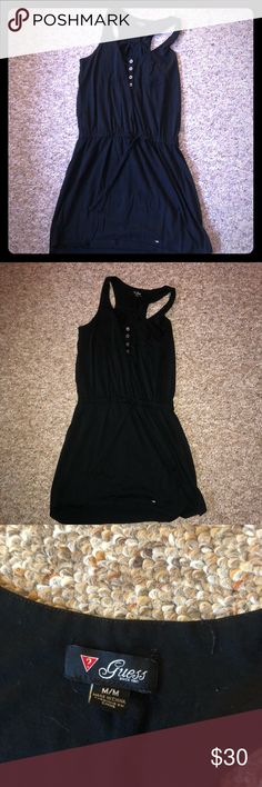 Black dress by Guess Black short skirt dress by guess. The top few buttons can unbutton. I am 5'2 and goes about 2 inches above my knee Guess Dresses Mini