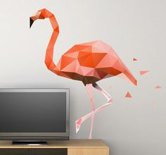 A magnificent wall sticker with a geometric design of a rare flamingo bird. Create bold and exciting looks on the walls of your home with the elegant pink colours of this graceful creature. #Flamingo #Wall #Decoration