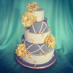 grey, white and yellow wedding cake