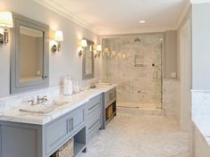 Carrera marble bathroom tile gray vanity white walls.