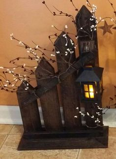 These cute primitive country Picket fences are made from reclaimed wood. A small lantern with a battery tea candle is included. A cute addition to your primitive decor. This fence has been stained Dark Walnut. You can choose your own stain options. It would look good on a Fireplace, by your front Door or just about anywhere. It measures 22 x 14 They are priced Individually.
