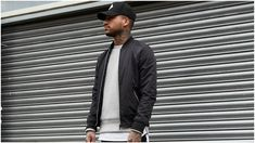 black bomber jacket grey sweatshirt black cap mens style
