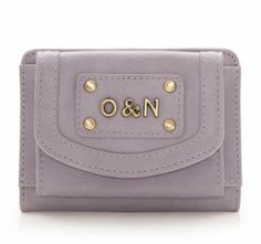 A compact purse with a press stud fastened pocket on the front and another compartment on the back with three credit card slots and an I.D. window. Branded with our O&N initials this cute little purse is ideal when you're on the go.  Features:  Press stud fastening  Front pocket  Three credit card slots  One clear I.D. window     Lining: Floral Cotton  Materials: PU     H8CM X L11CM X D2.5CM