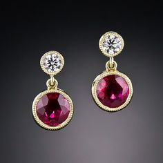 Small, high-quality ruby and diamond earrings are difficult to come across so we decided to create a pair ourselves. Our keen-eyed gemstone buyer has matched a pair of gorgeous vibrant red rubies and had them bezel-set and surmounted by sparkling round brilliant-cut diamonds in these sweet and petite traditional treasures crafted in rich 18 karat yellow gold.
