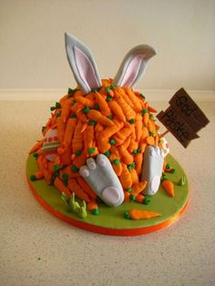 This is an Easter cake with Bugs Bunny covered in a pile of tiny carrots