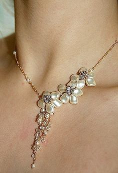 Samanta. Flower Cream/white Swarovski Pearls necklace (gold). $87.00, via Etsy.