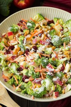 A delicious salad made with fresh broccoli, gala apples, carrots, dried cranberries, red onion, walnuts and a creamy, sweet and tangy dressing.