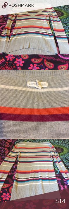 EUC striped v neck sweater No pilling, not even in the arm pits! Worn very little. I will warn you that the v is very, very low. I had to wear a cami under it. Pet free and smoke free home Aeropostale Sweaters V-Necks