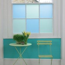 Frosted sea glass colored windows...such a sweet little spot to enjoy a cup of tea.