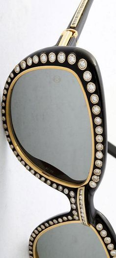 Custom Order Cartier-Gold-and-Diamond-Sunglasses ♥✤ in black plastic trimmed in 18 carat gold, with 188 collet set diamonds, in excess of 7.5 carats, dated to the 1980's, priced at $25,000.