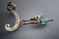 African rustic earrings • aquablue recycled glass • carved bone • elongated ethnic earrings • tribal jewelry • oxidized copper • metalwork by entre2et7 on Etsy