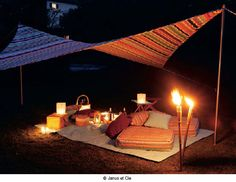 Romantic setting - bring candles to the beach.. awesome idea!