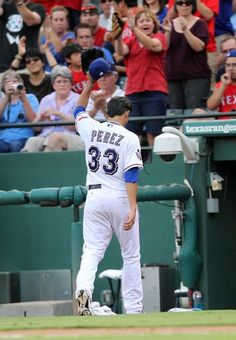 ARLINGTON, TX - JUNE 30: Martin Perez #33 of the Texas Rangers tips his hat to fans after leaving the game against the Oakland Athletics on June 30, 2012 at the Rangers Ballpark in Arlington in Arlington, Texas. The 21-year-old left-hander made his first big league start and was credited for the win. (Photo by Layne Murdoch/Getty Images)  game 79