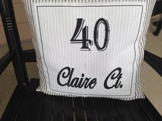 Cross stitch pillow I made for our front porch chair with our address...