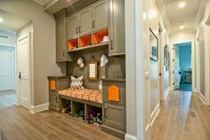 Love the colors especially the orange shelves but where do you hang a coat and how about something to contain the shoes?