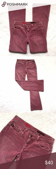 """AG Jeans Mulberry Corduroys Bootcut """"Angel"""" style cords with stretch from Adriano Goldschmied. Slim fit through the thigh opening to a slight bootcut. The color is Mulberry which is sort of a muted dusty pink. Zip fly with button closure. 98% cotton; 2% spandex. Size 27. Waist: 14"""" across. Rise: 7.5"""". Inseam: 31"""". Very slight wash wear. EUC. Thanks for looking! AG Adriano Goldschmied Jeans Boot Cut"""