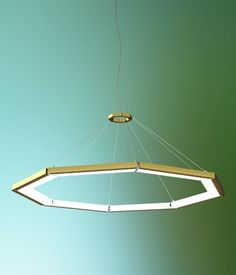 Neidhardt. Could we make something like this? Change to SS, have lights pointing upwards for reflective, and change from octagon to hexagon. Bathroom lighting.