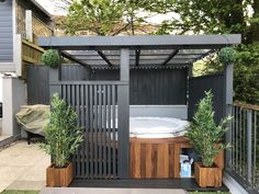 Modern grey pergola.Lazy spa hot tub, iroko surround