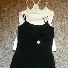 """Express """"Best Loved Cami' duo Brand new Express brand Best Loved Cami duo with built in shelf bra. Ivory is racer back style without adjustable straps. Black is Cami style with adjustable straps. Will sell separately for $11 each. Express Tops Camisoles"""